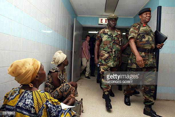 Nigerian General Festus Okonkwo leads the ECOWAS advance military delegation on a tour of the John F Kenndy Hospital where civil war victims are...