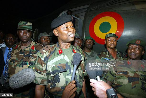 Nigerian General Festus Okonkwo speaks to the press 30 July 2003 after being met by US ambassador to Liberia John Blaney on his team's arrival at...