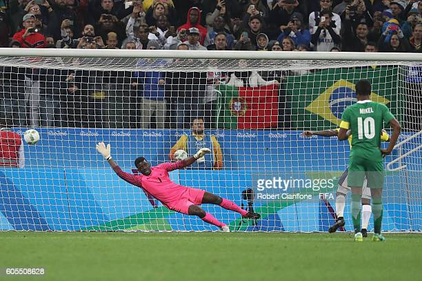 Nigerian goalkeeper Daniel Akpeyi fails to stop a penalkty taken by Dorlan Pabon of Colombia during the Men's First Round Group B match between...