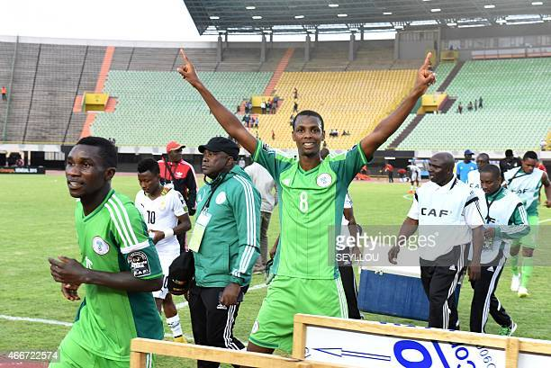 Nigerian Ibrahim Abdullahi celebrates after their victory in the African U20 Championships semifinal football match against Ghana on March 18 2015 in...