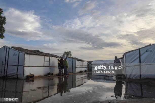 Nigerian Internally displaced women are seen on July 21, 2019 at an informal settlement in Madinatu, Old Maiduguri. - Boko Haram's decade-long...