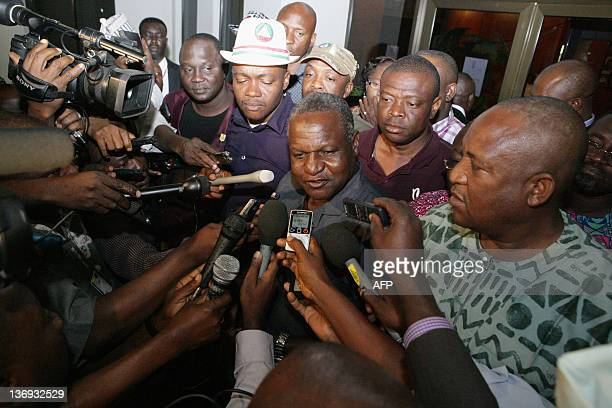 Nigerian Labour Congress representative Abdulwaheed Umar speaks to journalists following a meeting with the federal government in Abuja late on...