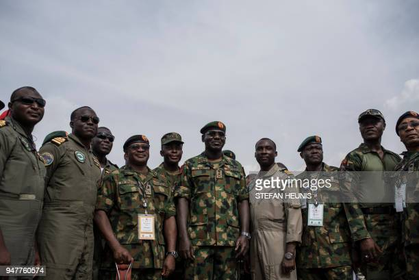 Nigerian Lieutenant General and the current Chief of Army Staff of Nigeria Tukur Yusuf Buratai stands surrounded by members of the Nigerian Armed...