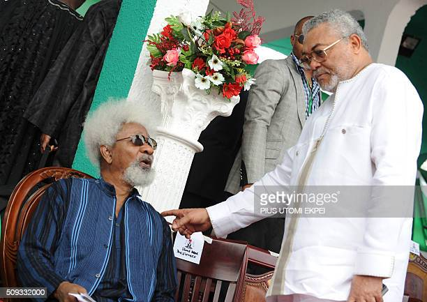 Nigerian Literature Nobel Wole Soyinka and former Ghanaian President Jerry Rawlings chat as they attend the national interdenominational funeral...