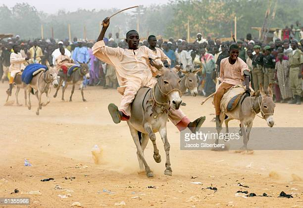 Nigerian men race donkeys during the Argungu Fishing Festival on March 18 2004 in Argungu Nigeria The Argungu Fishing Festival was first held in 1934...