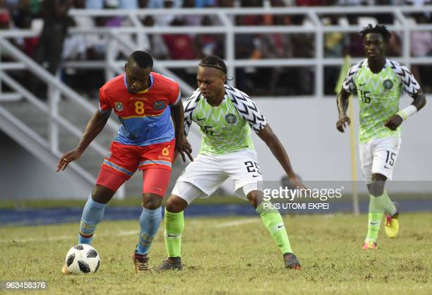 Nigerian midfielder Joel Obi tries to stop a Congolese attacker during an international friendly football match at the Adokiye Amiesimaka Stadium in...