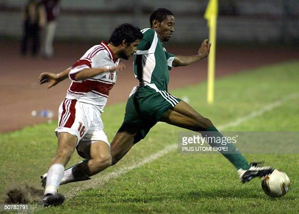 Nigerian midfielder Paul Obiefule fights for the ball with Jordanian Faisal Suleiman 28 April 2004 at the Lagos National Stadium Nigeria Super Eagles...