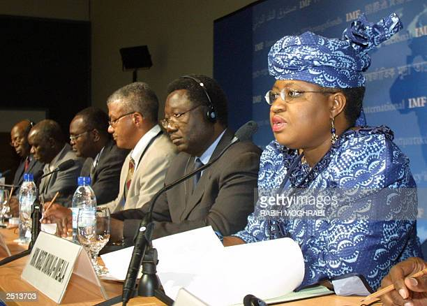 Nigerian Minister of Finance Ngozi OkonjoIweala talks to the press as Minister of Budget and Finance Jean Baptiste Compaore of Burkina Faso and...