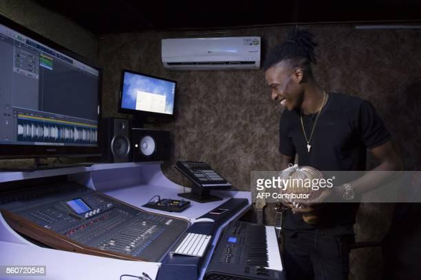 Nigerian music producer Chris Alvin Sunday, aka Krizbeatz, smiles