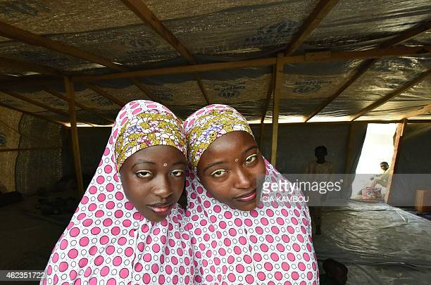 Nigerian Muslim refugee young women look on in a United Nations Refugee Agency refugee camp in Baga Sola by Lake Chad which borders Chad Nigeria...