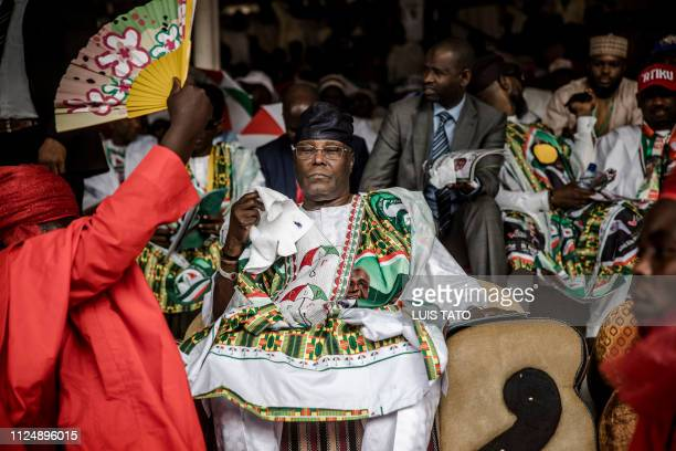Nigerian opposition Peoples Democratic Party presidential candidate Atiku Abubakar is fanned during his final campaign rally on February 14 at Ribadu...