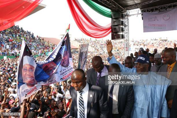 Nigerian opposition presidential candidate of the People's Democratic Party Atiku Abubakar waves during a campaign rally at the Ahmadu Bello Stadium...