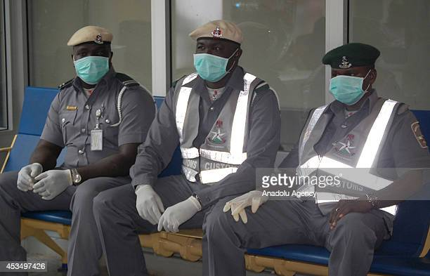 Nigerian Passengers arrive at International Nnamdi Azikiwe Airport in Abuja Nigeria to protect themselves from the Ebola infection on August 11 2014