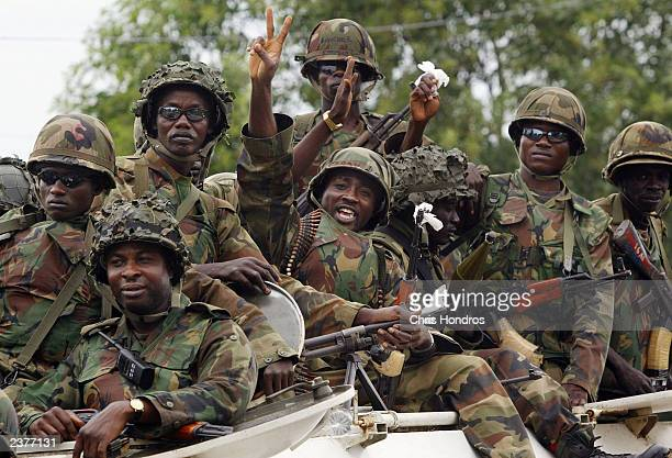 Nigerian peacekeepers wave and make a peace sign at joyful Liberians during their first rounds through the center of the capital August 7 2003 in...