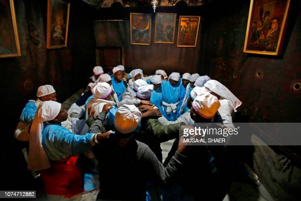 Nigerian pilgrims pray inside the Grotto, believed to be the exact spot where Jesus Christ was born, at the Church of the Nativity in the biblical...