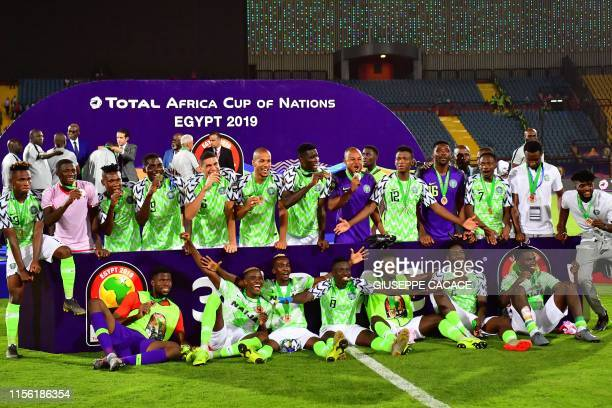 Nigerian players celebrate after winning the 2019 Africa Cup of Nations Third place playoff football match between Tunisia and Nigeria at the Al...