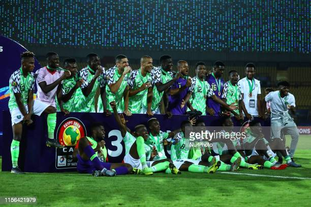 Nigerian players celebrate after winning the 2019 Africa Cup of Nations Third place playoff football match between Tunisia and Nigeria at the AlSalam...
