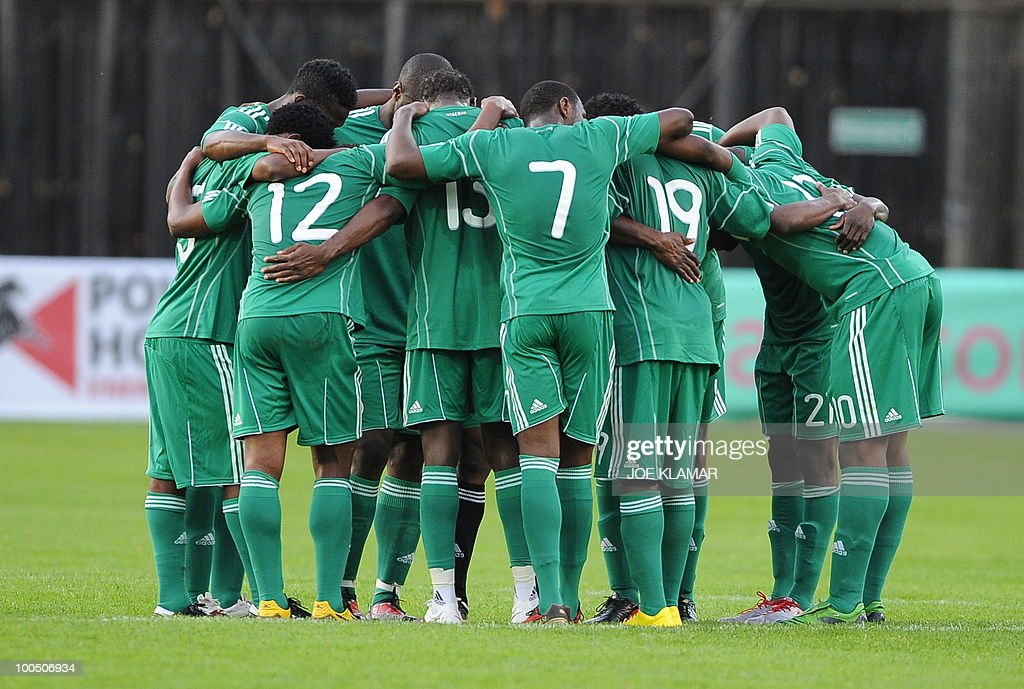 Nigerian Players pray during their friendly match between Saudi Arabia and Nigeria in Alpen stadium in Tyrolian Wattens on 25 May 2010 prior to the FIFA World Cup 2010 hosted by South Africa.