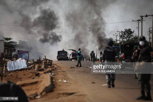 Nigerian Police fire teargas at people during clashes between youths in Apo, Abuja, Nigeria, on October 20 following the ongoing demonstrations...