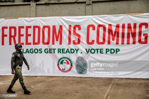A Nigerian Police Officer monitors the entrance of Tafawa Balewa Square in Lagos where the People's Democratic Party opposition party is holding a...