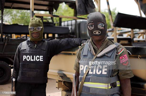 Nigerian police part of the joint forces in Borno state pose prior to a patrol in former Boko Haram headquarters in Maiduguri on June 5 2013...