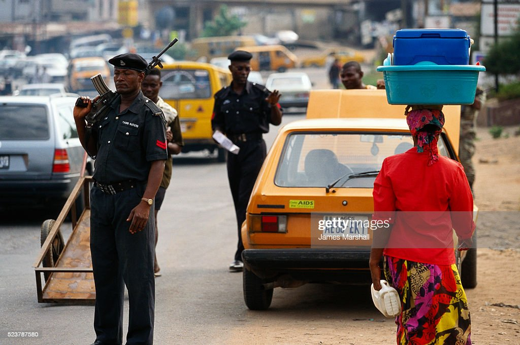 Nigerian Police Searching Car : Stock Photo