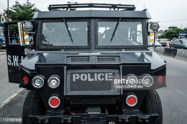 Nigerian police SWAT personnel members sit in a vehicle stationed at the entrance of Rivers State collation centre in Port Harcourt Southern Nigeria...
