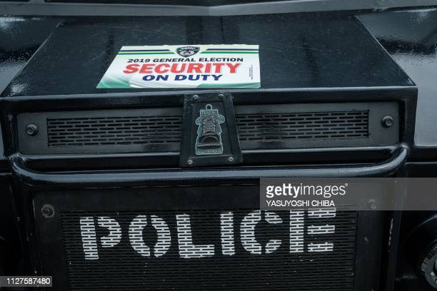 A Nigerian police SWAT vehicle with an election placard stands stationed at the entrance of Rivers State collation centre in Port Harcourt Southern...
