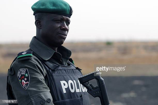 A Nigerian policeman patrols with Nigerian soldiers in the north of Borno state on June 5 2013 near Maiduguri Nigeria's military yesterday disclosed...