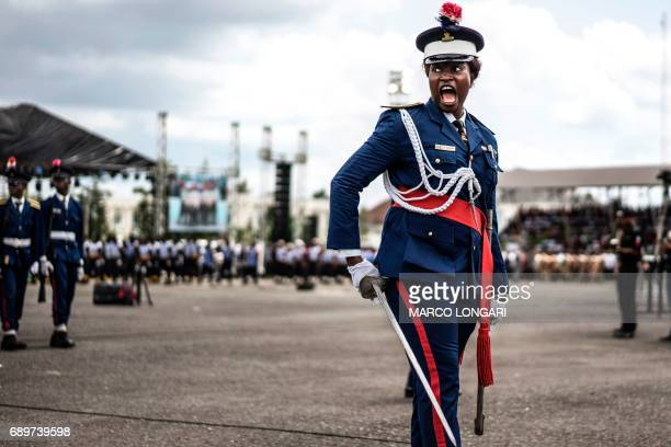 Nigerian policewoman gives an order as she marches in front of authorities and members of the public during a Democracy Day parade on May 29 2017 in...
