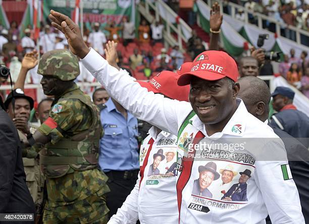 Nigerian President and presidential candidate of the ruling People's Democratic Party Goodluck Jonathan waves to supporters as he arrives to campaign...