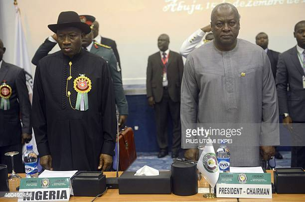 Nigerian President Goodluck Jonathan and his Ghanaian counterpart John Mahama stands for the regional anthem during the Summit of ECOWAS Heads of...