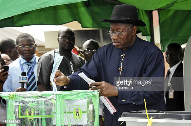 Nigerian President Goodluck Jonathan casts his ballot in Otuoke on March 28 2015 Voting began in Nigeria's general election but delays were reported...