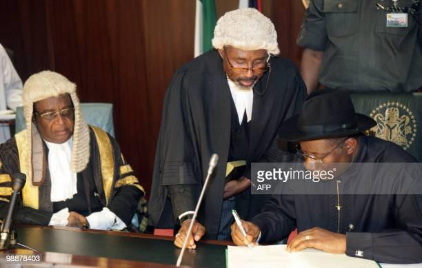 Nigerian President Goodluck Jonathan is sworn in by cheif justice Aloysius Katsai Alu in Abuja on May 6 2010 Nigeria's Goodluck Jonathan took over...