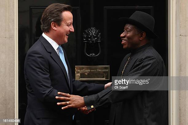 Nigerian President Goodluck Jonathan is welcomed to Downing Street by British Prime Minister David Cameron on February 11 2013 in London England...