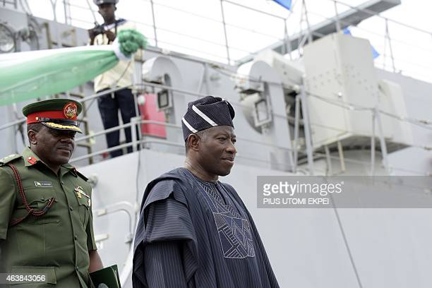 Nigerian President Goodluck Jonathan leaves after inspecting the NNS Centenary an offshore patrol vessel built by Chinese Shipbuilding and Industry...