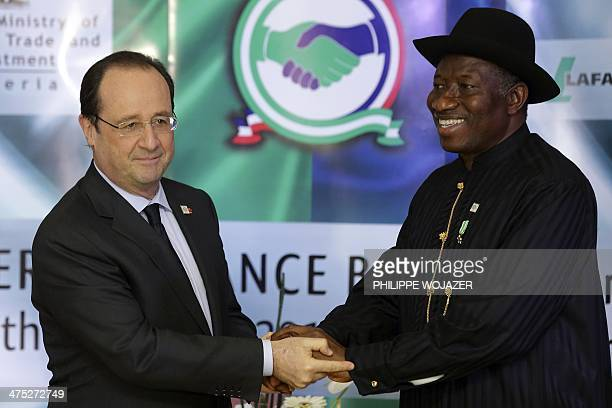 Nigerian President Goodluck Jonathan shakes hands with French President Francois Hollande after they opened the NigeriaFrance business forum in Abuja...