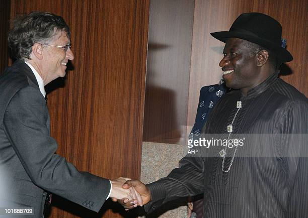 Nigerian President Goodluck Jonathan shakes hands with the President of the Bill and Melinda Gates Foundation Bill Gates at the presidential villa...