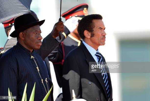 Nigerian president Goodluck Jonathan stands beside his Botswanan counterpart Ian Khama after arriving in Gaborone on September 112012 Nigerian...