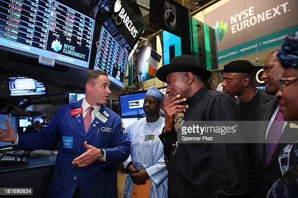 Nigerian President Goodluck Jonathan walks on the floor of the New York Stock Exchange before ringing the closing bell on September 23 2013 in New...