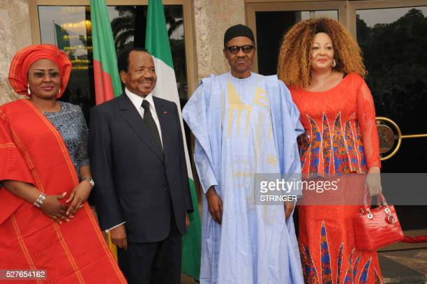 Nigerian President Mohammadu Buhari and his Cameroonian counterpart Paul Biya pose with their wives Chantal Biya and Aisha Buhari at the presidential...