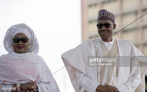 Nigerian President Mohammadu Buhari arrives with his wife Aisha before taking oath of office at the Eagles Square in Abuja on May 29 2015 Buhari...