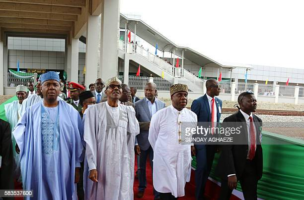 Nigerian President Mohammadu Buhari flanked by Senate President Bukola Saraki and Transport Minister Rotimi Amaechi tours the country's first ever...