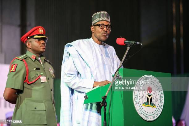 Nigerian President Muhammadu Buhari addresses the audience following his reelection after Nigeria's Independent National Electoral Commission...