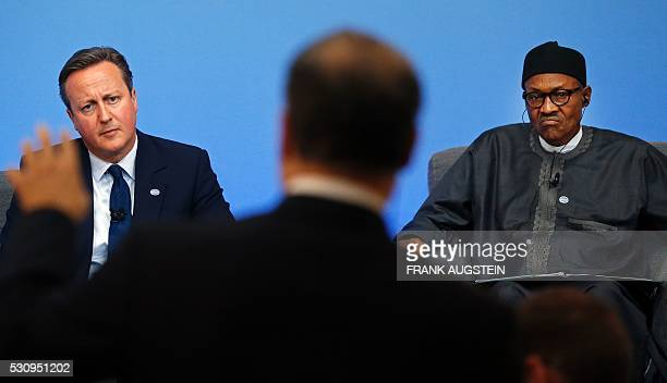 Nigerian President Muhammadu Buhari and British Prime Minister David Cameron attend a panel discussion during the AntiCorruption Summit London 2016...