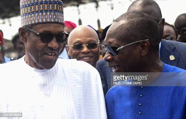 Nigerian President Muhammadu Buhari and his Beninoise counterpart Patrice Talon speak next to President of ECOWAS Commission JeanClaude Brou during...