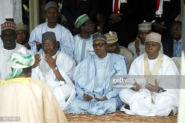 Nigerian president Muhammadu Buhari and Nigeria's Senate President Bukola Saraki are seen at Abuja National Mosque during the prayer on July 17 to...