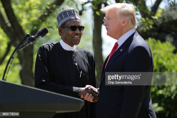 Nigerian President Muhammadu Buhari and US President Donald Trump shake hands at the conclusion of their a joint press conference in the Rose Garden...