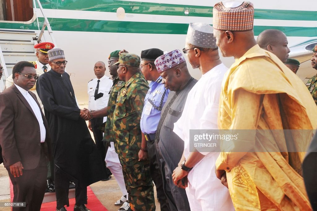 Nigerian President Muhammadu Buhari disembarks from an aircraft upon his arrival at the Nigerian Airforce base in Kaduna, on March 10, 2017. Buhari arrived back in Nigeria on March 10 after nearly two months in London receiving treatment for an undisclosed ailment. The 74-year-old landed at the airport in the northern city of Kaduna at about 7:40 am (0640 GMT) and was flown by helicopter to the capital, Abuja. /