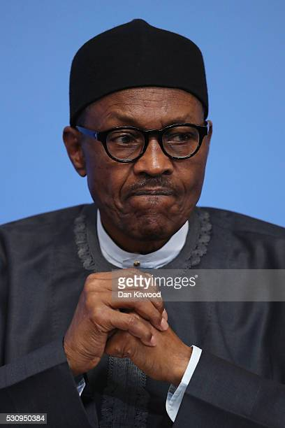 Nigerian President Muhammadu Buhari listens as British Prime Minister Cameron opens the international anticorruption summit on May 12 2016 in London...